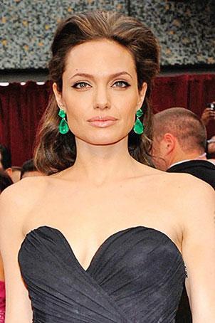 Angelina Jolie in elegant briolette-shaped Emerald Drop Earrings